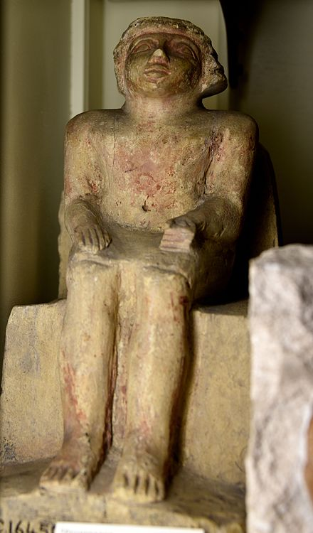 Seated statue of an official on block chair. Limestone. 6th Dynasty. From Egypt. The Petrie Museum of Egyptian Archaeology, London Seated statue of an official on block chair. Limestone. 6th Dynasty. From Egypt. The Petrie Museum of Egyptian Archaeology, London.jpg