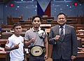 "Senator Joseph Victor Ejercito poses with two-time Muay Thai World Champion Ernesto ""Iron"" Montella Jr.jpg"