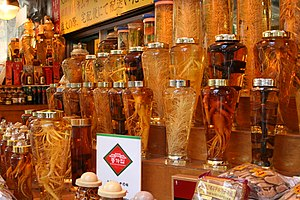 Ginseng - Ginseng and reishi mushrooms in bottles being sold