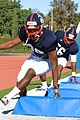 Shaun McGee, a defense lineman with the east coast team for the Semper Fidelis All- American Bowl, sprints through a series of obstacles during practice drills in Fullerton, Calif 130102-M-EK802-982.jpg