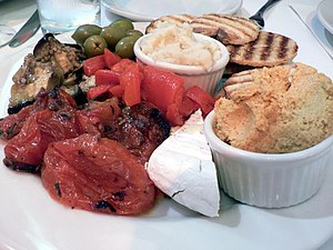 Skordalia - Skordalia (center) with hummus, vegetables and pita