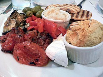 Skordalia - Skordalia (center) served with hummus (right), vegetables and pita bread