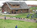 Sled dogs and log building as viewed from the Riverboat Discovery.jpg