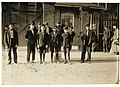 Smallest boy is Joseph Fortin, 71 Cocheco St. His mother (at home) said he is 14 years old. He does not look it. 6-00 A. M., May 15, 1909. Group going into Mill No. 1. Cocheco Mfg. Co., LOC nclc.01776.jpg