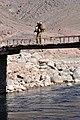 Soldier crosses a hand-made bridge over the Tiri Rud River, Afghanistan.jpg