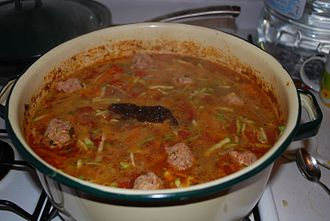 Simmering - Meatball Soup simmering on a stove.