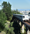 Southbound BART train passes Outer Mission in San Francisco between Balboa Park station and Daly City station.png