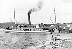 Steamer Dufferin at the Government Wharf, Port Dufferin, with Smiley & Company's Lobster Crates awaiting Transport to Halifax, Nova Scotia, Canada, ca. 1910.jpg