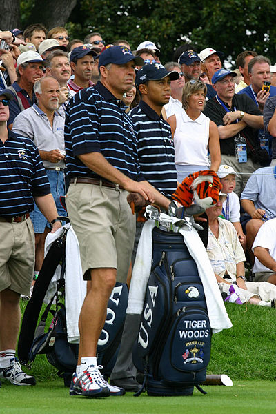 Steve Williams caddies with Tiger Woods