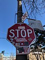 Stop sign with stickers.jpg