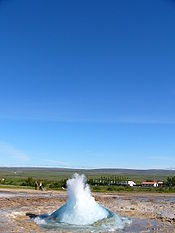Circle of water, with a geyser filling the circle of water.