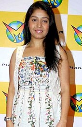 Sunidhi Chauhan posing for a photo looking to the camera