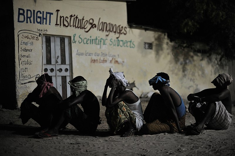 File:Suspected al Shabab militants wait to be taken off for interogation during a joint night operation between the Somali security services and AMISOM forces in Mogadishu, Somalia, on May 4. AU UN IST (14114007504).jpg