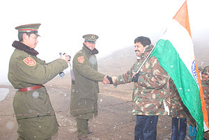 Gopinath Muthukad - Greeting Chinese soldiers at Nathu La Pass, 14400 feet atop Gangtok, Sikkim, after a magic show.
