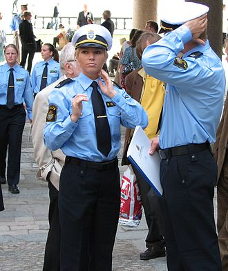 Women in law enforcement - A Swedish policewoman with her male counterpart