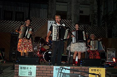 A recent photo of Those Darn Accordions performing in Champaign, Illinois. TDALive.jpg