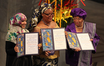 From left to right: Tawakkul Karman, Leymah Gbowee, and Ellen Johnson Sirleaf display their awards during the presentation of the Nobel Peace Prize, 10 December 2011 (Photo: Harry Wad). Tawakkul Karman Leymah Gbowee Ellen Johnson Sirleaf Nobel Peace Prize 2011 Harry Wad.jpg