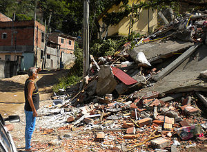 April 2010 Rio de Janeiro floods and mudslides - A resident of São Gonçalo stands in front of his destroyed house.