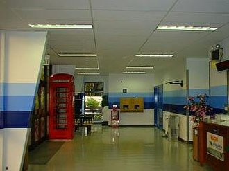Depopulation of Chagossians from the Chagos Archipelago - Passenger terminal at Diego Garcia airport, with functioning red British telephone booth