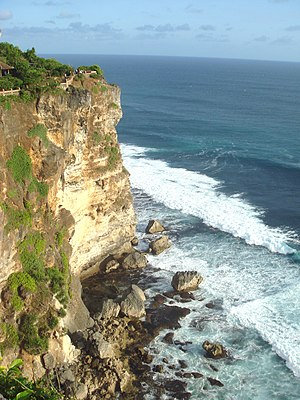 History of Bali - The Tertiary limestone cliffs of Uluwatu were lifted from the sea floor by subduction.