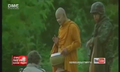 Thai Buddhist monk going on alms round in a southern province, protected by a soldier.png
