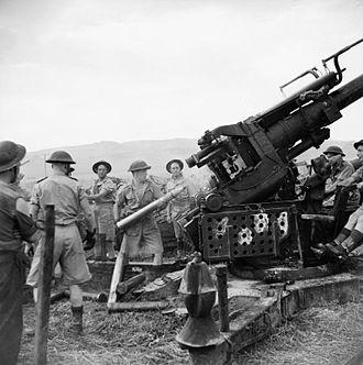 Hampshire Yeomanry - 3.7-inch gun operating in the field gun role in Tunisia.