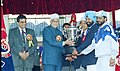 The Deputy Prime Minister Shri L.K. Advani giving away the prizes at the closing ceremony of the 52nd All India Police Athletic Championship-2003 in New Delhi on December 12, 2003.jpg