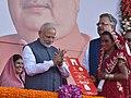 The Prime Minister, Shri Narendra Modi felicitates the beneficiaries of different schemes, at Naya Raipur, Chhattisgarh on November 01, 2016. The Chief Minister of Chhattisgarh, Dr. Raman Singh is also seen (1).jpg