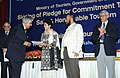 """The Union Minister for Tourism & Housing and Urban Poverty Alleviation, Kum. Selja receiving a signed pledge document for commitment towards """"Safe and Honourable Tourism"""" and """"Sustainable Tourism"""" from the President of FHRAI.jpg"""