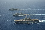 The amphibious dock landing ship USS Rushmore (LSD 47), top, amphibious transport dock ship USS Green Bay (LPD 20), center, and amphibious assault ship USS Peleliu (LHA 5) steam in formation in the Pacific Ocean 130423-N-ZM744-1427.jpg
