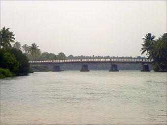 Estuaries of Paravur - Thekkumbhagam-Kappil bridge as seen from Paravur Estuary. This bridge is the official border of Paravur town towards south