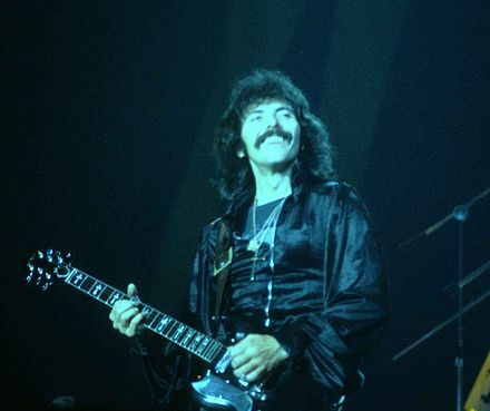 Iommi playing with Black Sabbath in 1978. Tony Iommi at the New Haven Coliseum.jpg
