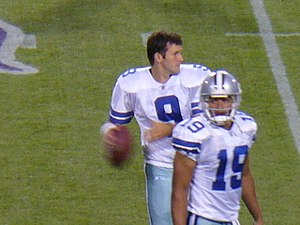 Miles Austin - Austin (bottom) and Tony Romo.