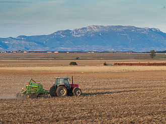 Agriculture in Spain - A tractor with a John Deere seed drill, La Rioja.