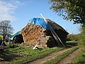 Traditional straw stack, partially thatched - geograph.org.uk - 605819.jpg