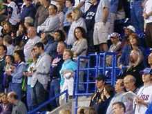 Crowd standing at the Metrodome, watching a Twins baseball game