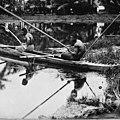 Two men fishing from canoe, Samoa 1914.jpg