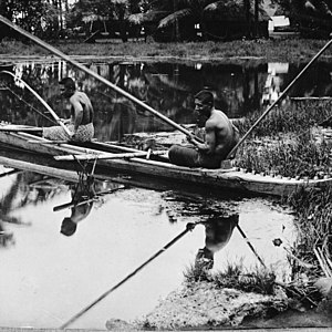 Savai'i - Two men fishing from canoe, 1914