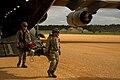 U.S. Air Force Lt. Col. Monsita Faley, a flight nurse with the 34th Aeromedical Evacuation Squadron (AES), and Senior Airman Zachary Freeman, an aeromedical service journeyman with the 18th AES, unload medical 140314-F-RW714-206.jpg