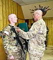 U.S. Army Command Sgt. Maj. Ted Copeland, right, the senior enlisted adviser to the commander of the 311th Sustainment Command, presents the Army Commendation Medal to Staff Sgt. Andrew Webb, with Headquarters 130327-A-KX461-029.jpg