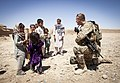U.S. Army Staff Sgt. Matthew Parsons, assigned to Police Adviser Team Delaram, interacts with children in Delaram, Helmand province, Afghanistan, May 26, 2013, during an operation with Afghan National Civil 130526-M-RO295-199.jpg