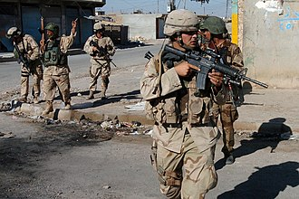 Battle of Tal Afar (2005) - U.S. Army soldiers and Iraqi soldiers patrolling through downtown Tal Afar, Iraq, September 11, 2005.