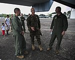 U.S. Marine Corps Col. John M. Peck, center, the chief of staff of the 3rd Marine Expeditionary Brigade (MEB), observes an MV-22B Osprey tiltrotor aircraft assigned to the 3rd MEB, III Marine Expeditionary Force 131005-M-GX379-127.jpg