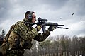 U.S. Marine Sgt. Travis Riggs, with the Marine Security Augmentation Unit (MSAU), engages his target during a weapons field test of the M27 Infantry Automatic Rifle at Marine Corps Base Quantico, Va., Feb. 21 140221-M-RO295-672.jpg