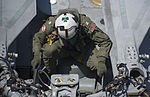 U.S. Navy Lt. Christopher Danielczyk, assigned to Helicopter Sea Combat Squadron (HCS) 7, prepares an MH-60S Seahawk helicopter for flight operations on the flight deck aboard the aircraft carrier USS Harry S 130812-N-GR168-207.jpg