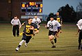 U.S. Navy Senior Chief Sonar Technician (Surface) Ben Pierson, second from left, the senior enlisted adviser for the U.S. Naval War College (NWC), runs for a first down during an Army-Navy flag football game 131206-N-PX557-303.jpg