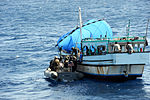 U.S. Sailors and Marines with the visit, board, search and seizure team, currently assigned to the guided missile cruiser USS San Jacinto (CG 56), board a suspicious dhow, from a rigid hull inflatable boat 100524-N-EF447-182.jpg