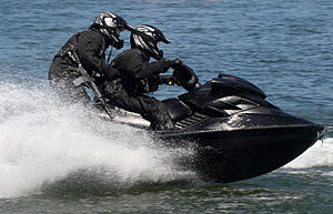 Grup Gerak Khas - Two members of 11 RGK using jet ski during a demo at Banding Lake, Perak. One of them is armed with a Colt M4A1 assault rifle.