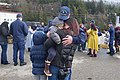 USCG sailor Andrew McCormick greets his family when his vessel, the new USCGC John McCormick reaches Ketchikan.jpg