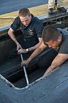 USS Carl Vinson sailors conduct maintenance 140905-N-TP834-937.jpg